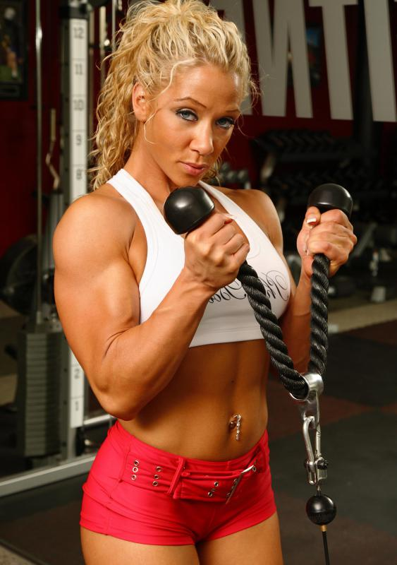 Women bodybuilders typically need to mix weight training with cardio exercises to gain muscle and definition.
