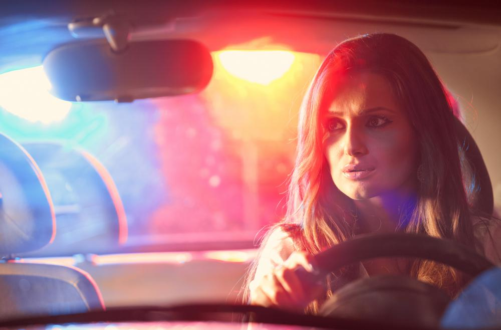 A person can receive a traffic ticket in a parking lot if she hits another car and tries to escape.