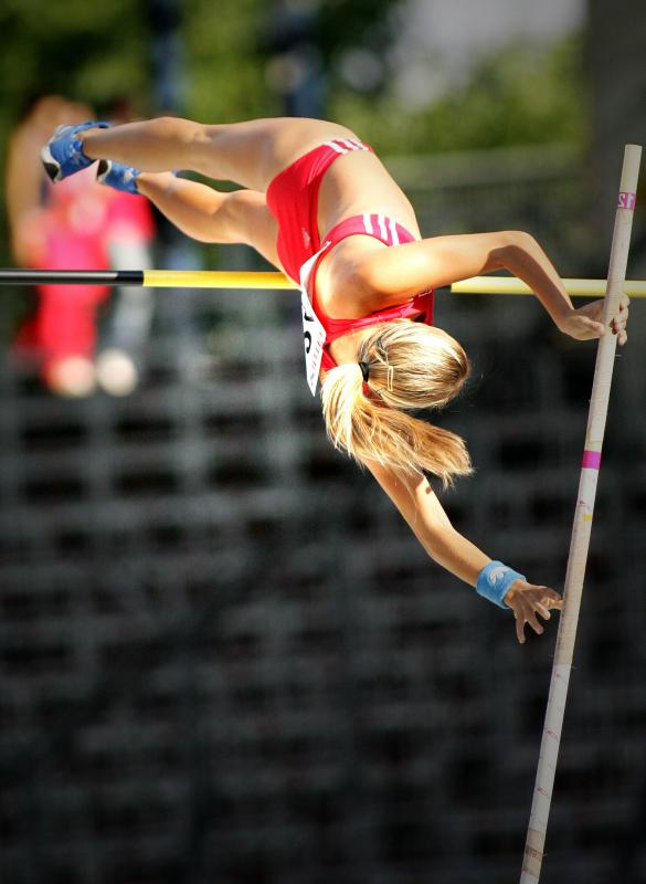 Pole vaulters contort their bodies to maximize the heights they can reach.