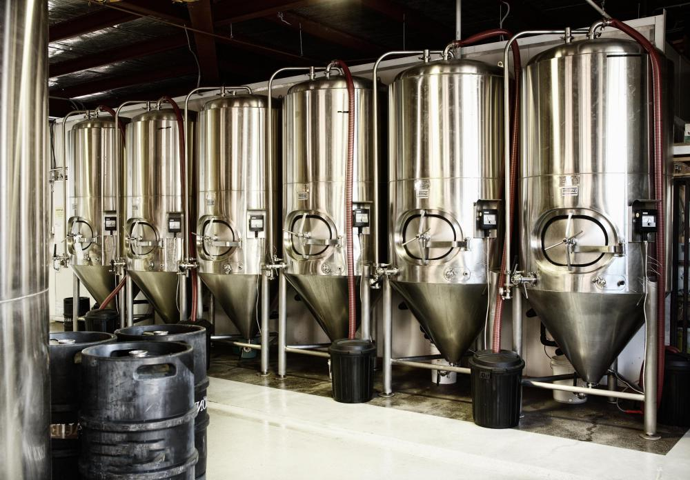 The fermentation process produces carbonation in beer.