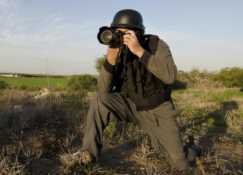 A press photographer might specialize in war photography.