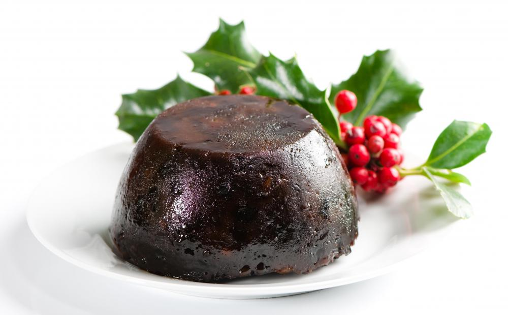 Figgy pudding decorated with holly.