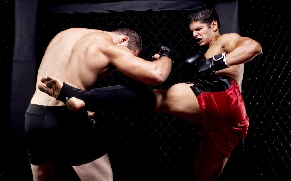 Muay Thai kickboxing is a form of martial arts that originated in Thailand.