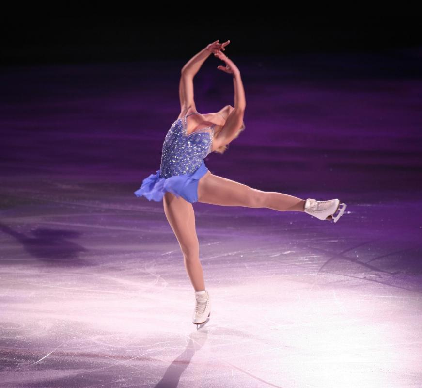 An ice skater must be very flexible to perform jumps and spins.