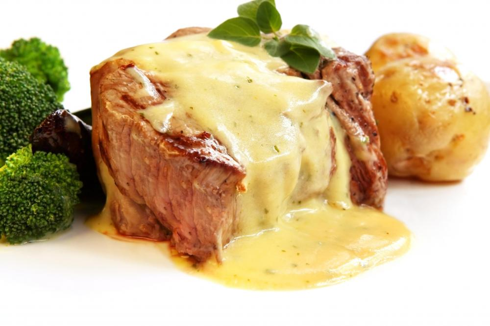 Filet mignon can be served with Bernaise sauce for added flavor.