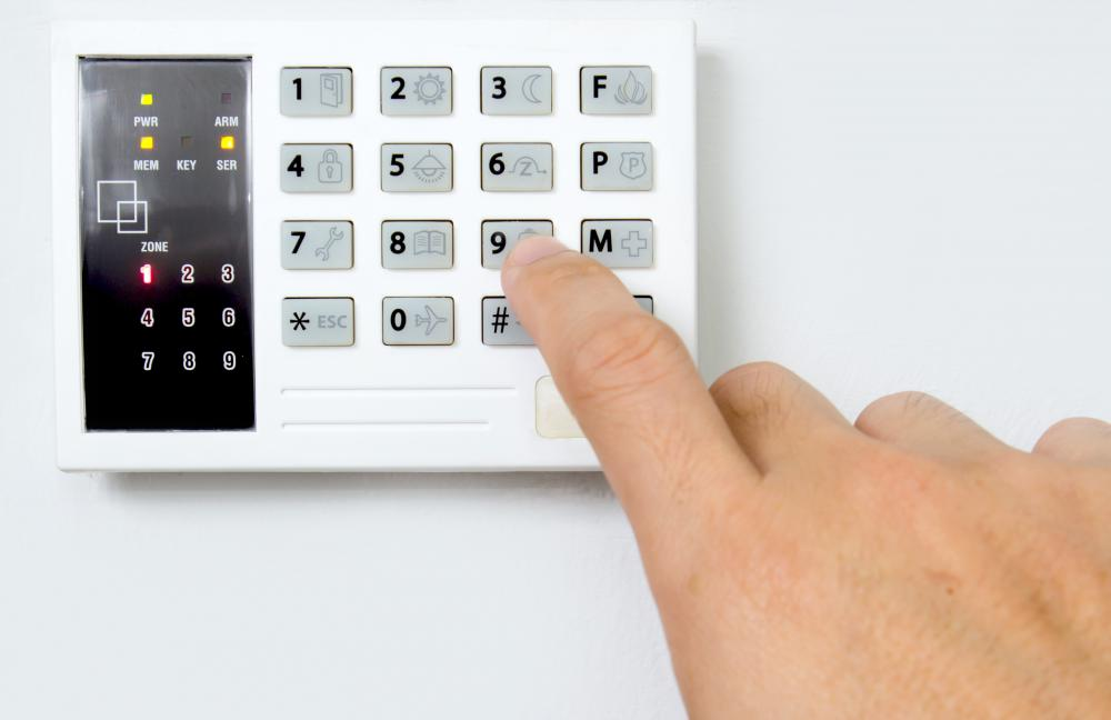 The main console of a home surveillance system typically features a keypad allowing homeowners to enter a code to turn the system on and off.
