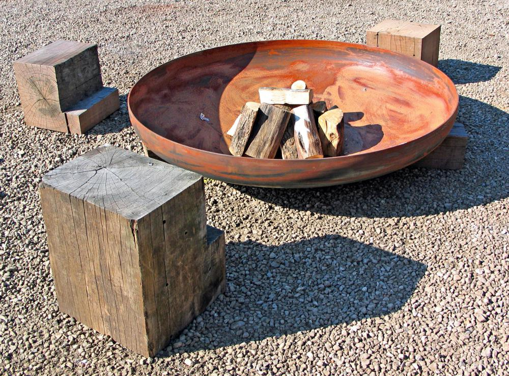 Fire pit logs often need to sit for a season to dry adequately before being burned.