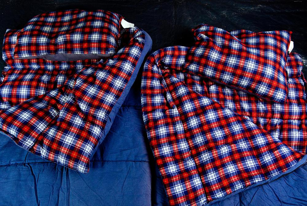 Flannel-lined sleeping bags help keep campers warm.