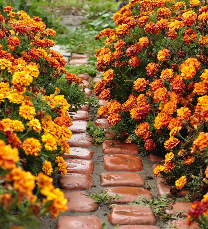 Using recycled materials such as old bricks can make a DIY landscaping project stand out.