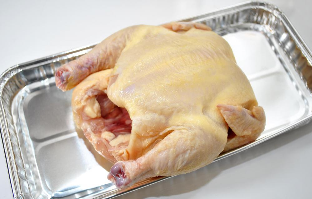 Rinsing raw chicken in a sink can spread bacteria.