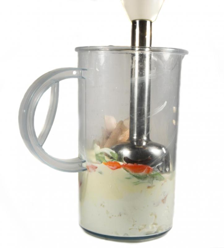 A handheld food processor may be used to chop or puree food.