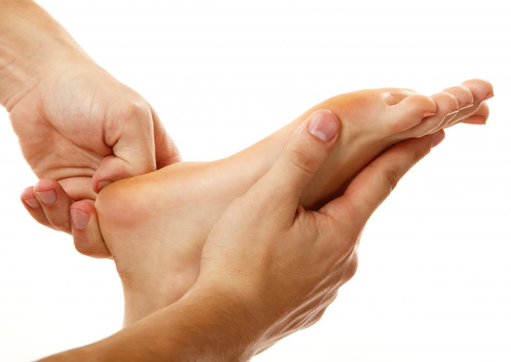 A person getting foot acupressure.