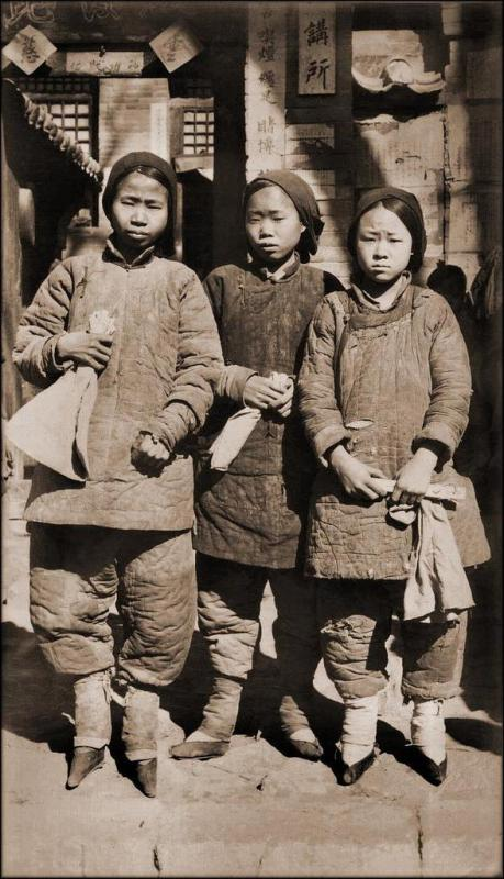 A group of girls from the Qing dynasty who had their feet bound, despite it being banned..