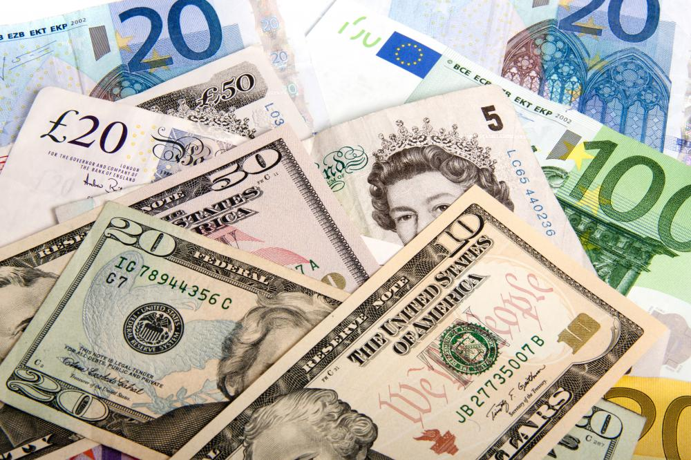 Various types of currency, including US dollars, pounds sterling, and euros.