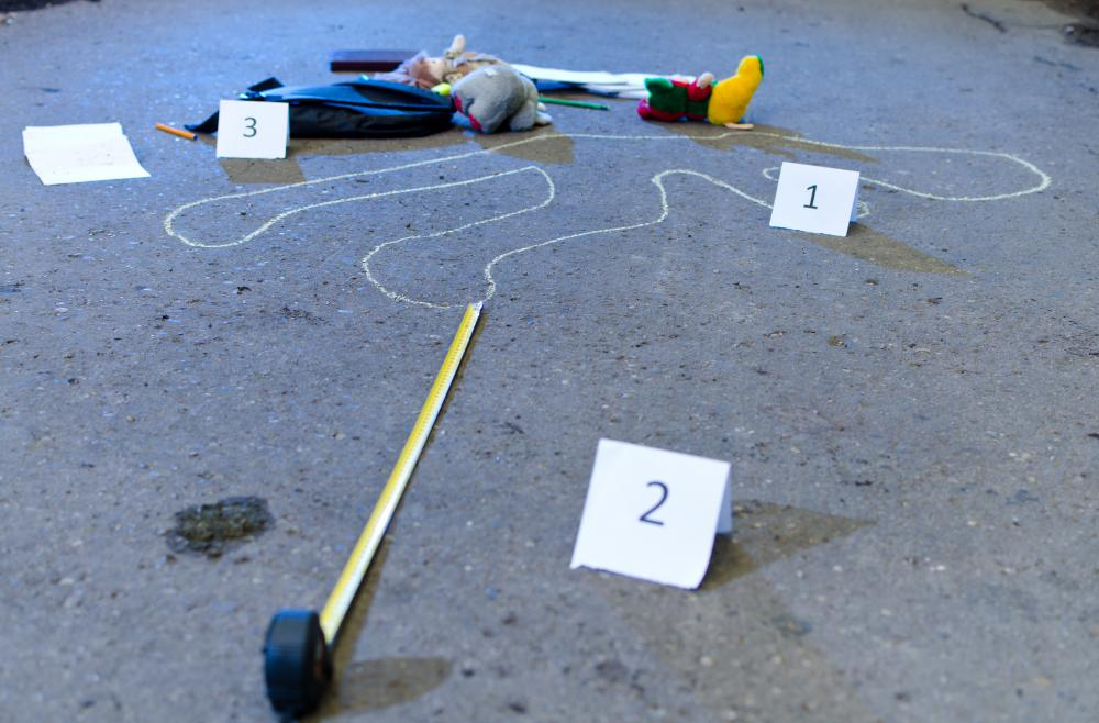 An FBI profiler may examine evidence at a crime scene.