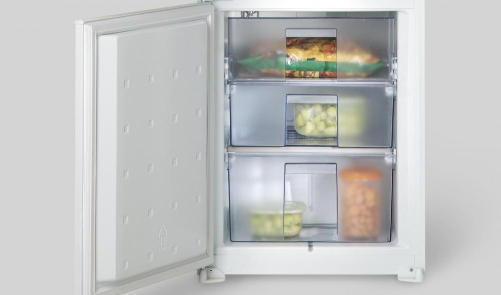 Compact refrigerators may have different sections to store various items.