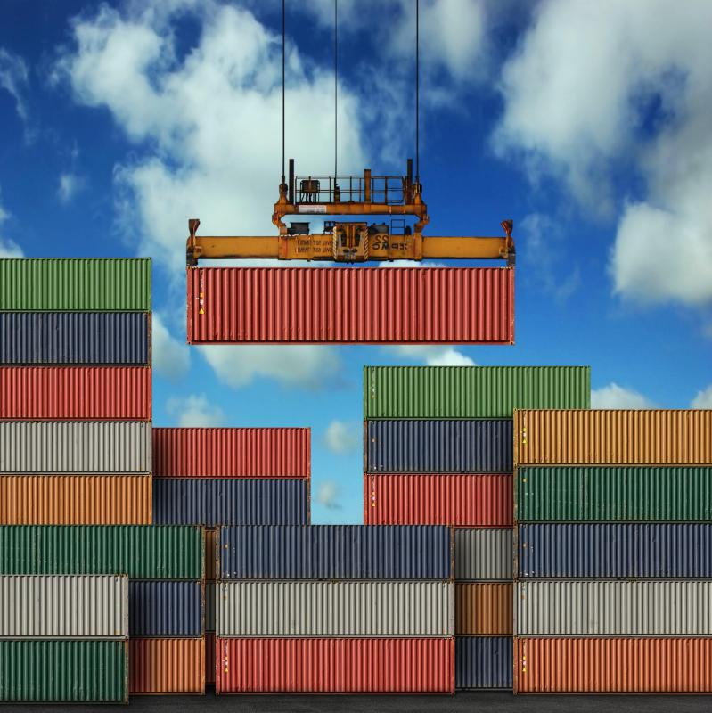 Merchant seamen may assist with the offloading of intermodal containers from a ship.