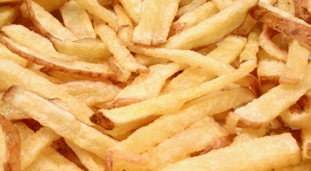 French fries cooked in a deep fryer.