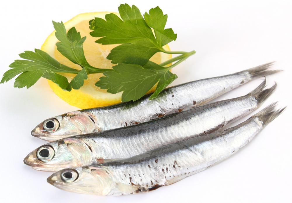 Anchovies are cut into small pieces and mashed to make anchovy dressing.