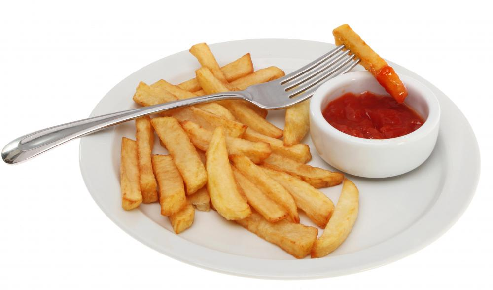 Ketchup may be served with fries.