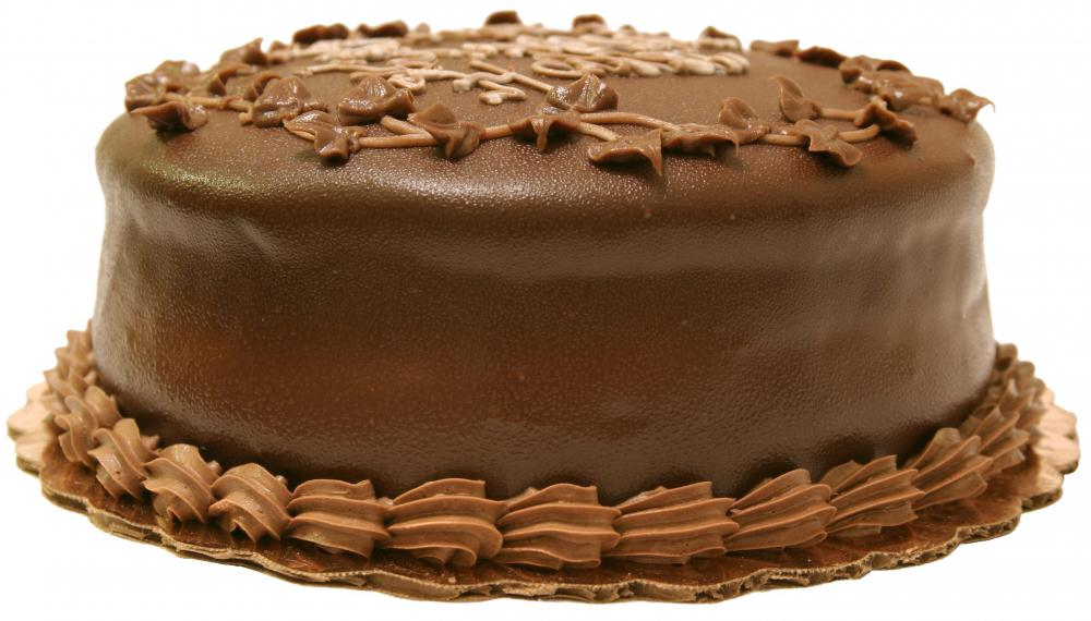 A cake with dark chocolate frosting.
