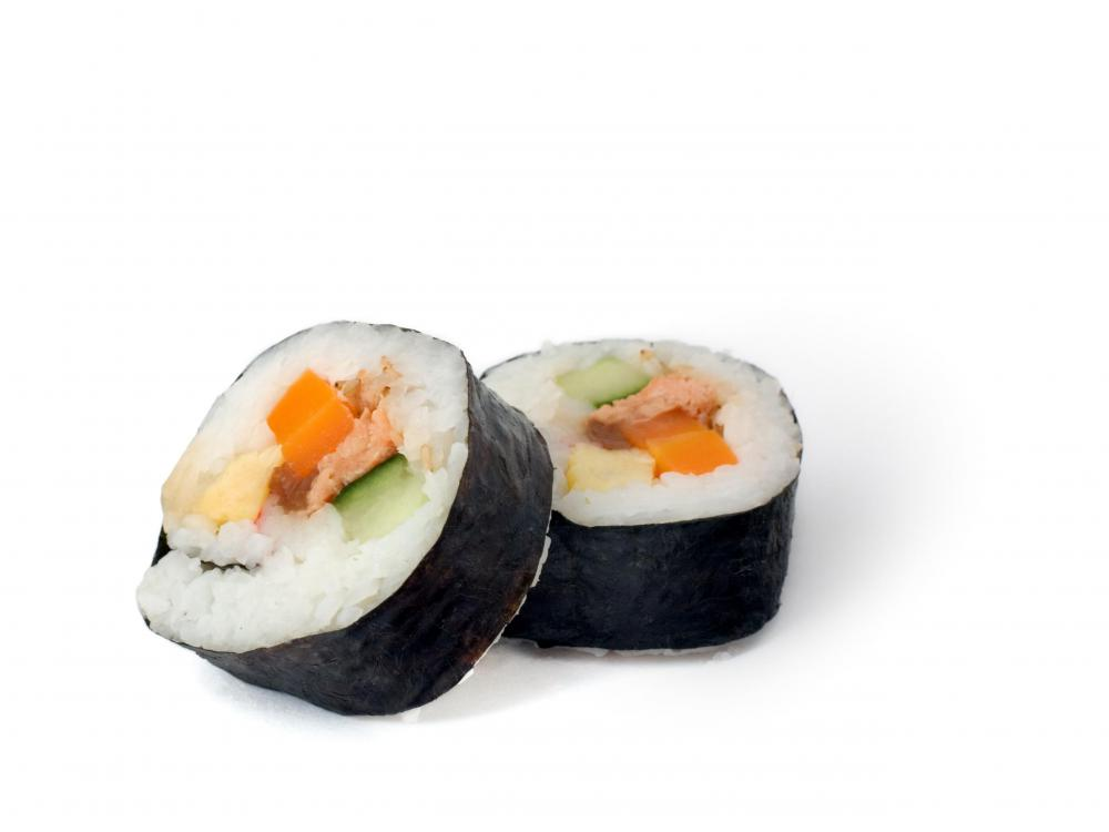 Sushi is often served with light soy sauce.