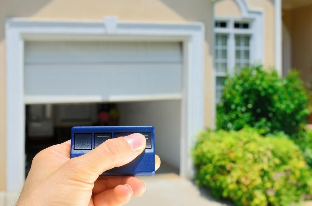 An Automatic Garage Door Opens And Closes Through Remote Controls Or  Switches.