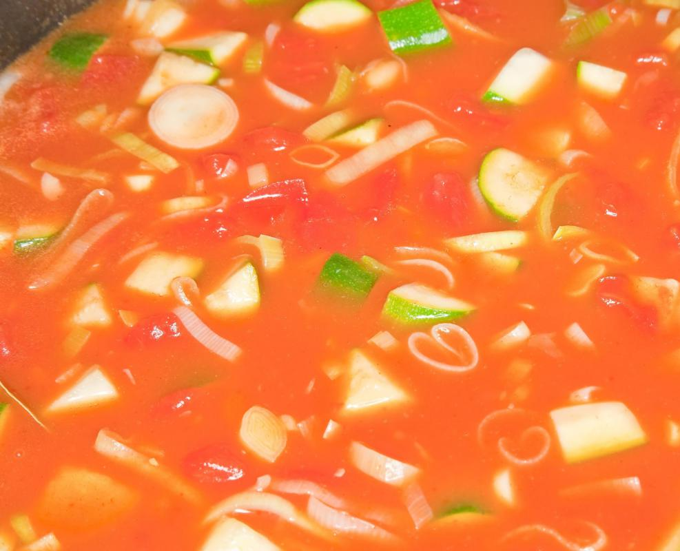 A tomato-based soup with fresh vegetables is an easy summer meal.