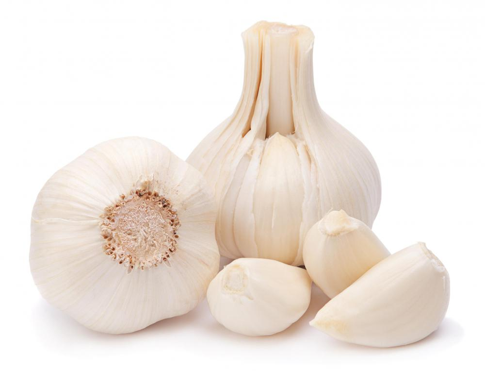 Making pickled garlic involves soaking fresh garlic cloves in vinegar.