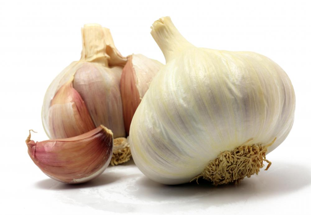 Garlic cloves may be finely chopped and added to black bean soup for flavor.