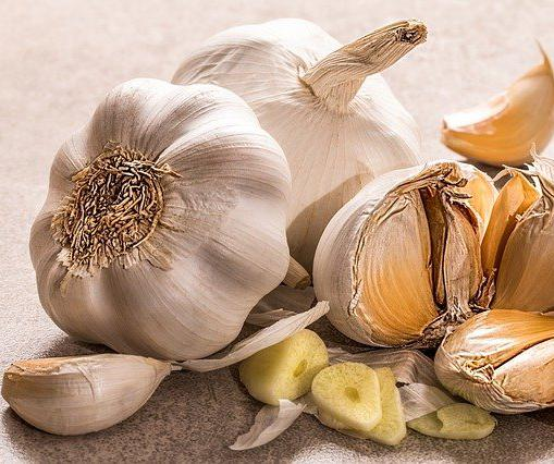 "You can ""taste"" garlic by stepping on a cut or crushed clove. Garlic has a compound called allicin that can penetrate your pores and travel in your bloodstream to your mouth and nose."