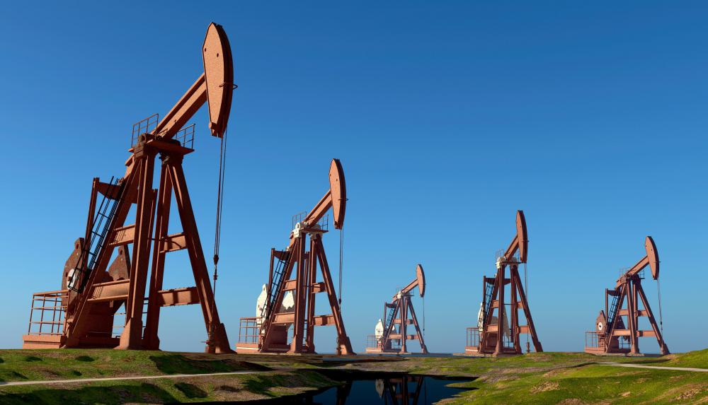 oil drilling machine. once an oil deposit has been accessed through a drill, pumpjacks are often placed over the well to pump out crude oil. drilling machine l