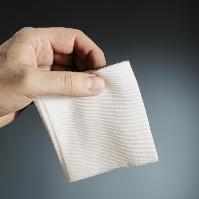 Gauze pads are pieces of fabric used to cover a wound.