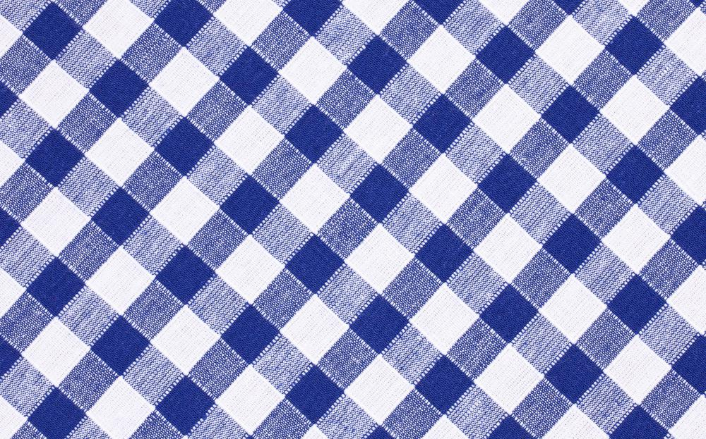 Gingham fabric may be used to create country kitchen curtains.