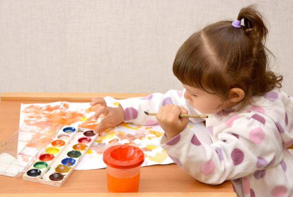 A child care worker may keep children engaged in creative activities, such as art.