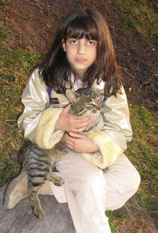 "In the sentence, ""the girl held her cat,"" the word ""her"" is a possessive adjective because it describes possession of the noun, ""cat."""