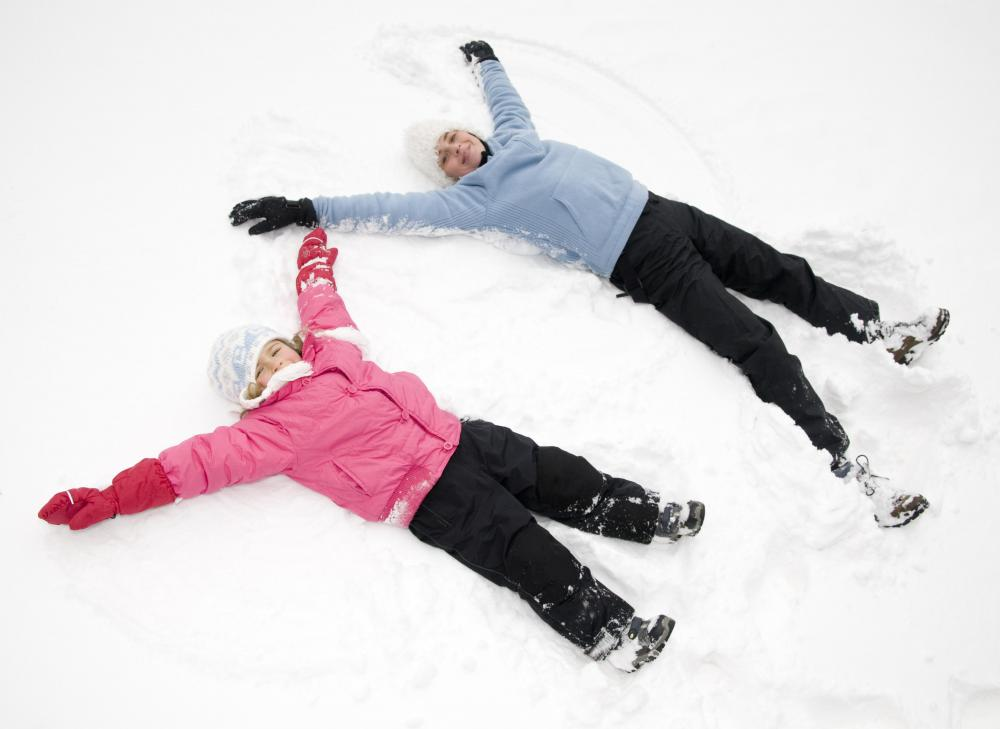 Making snow angels are a popular winter time activity for children.