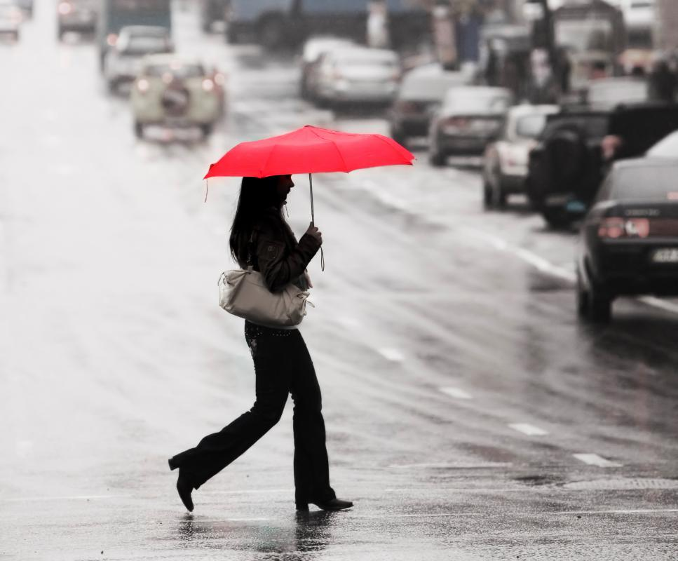 A person who chooses to walk in the rain ultimately spends more time in the weather than someone who is running.
