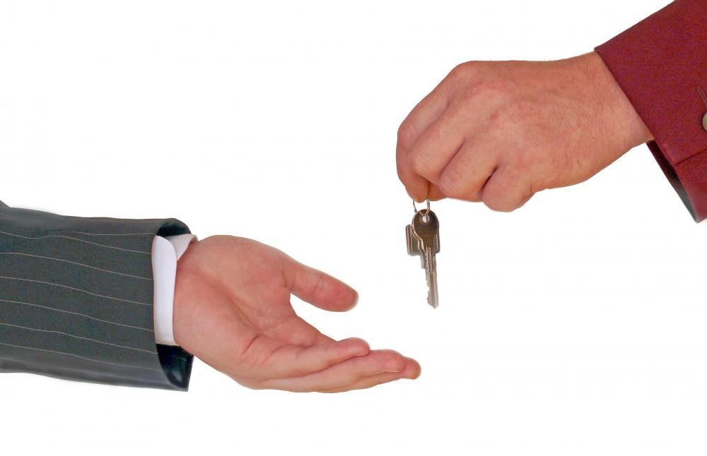 A person returning keys to a repossessor.