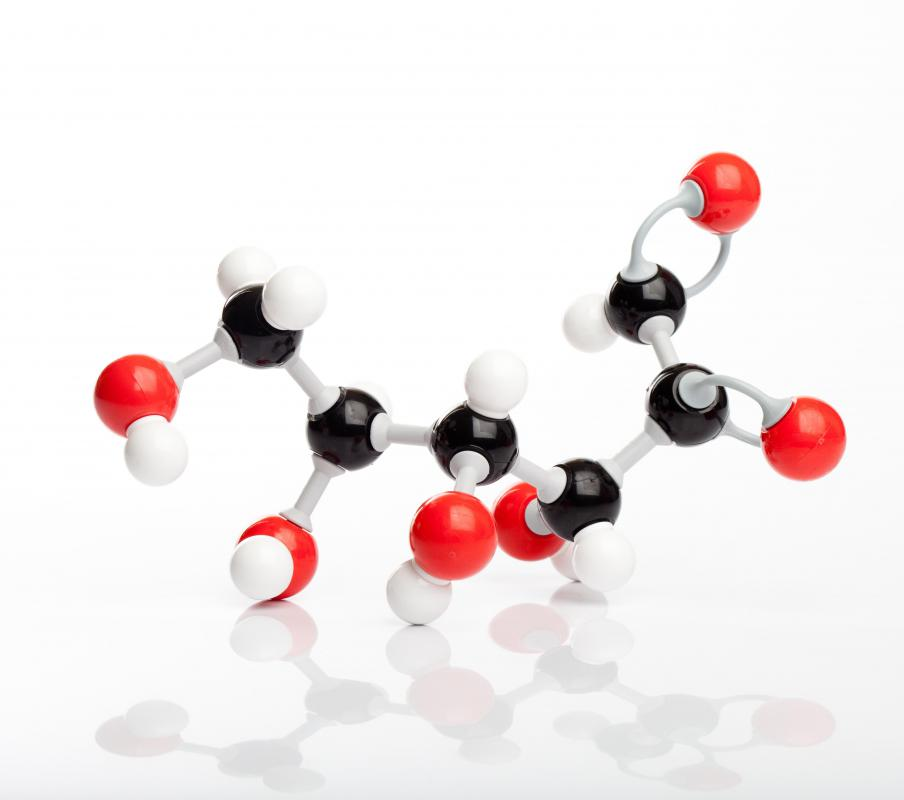 A molecule of glucose, which is broken down by an organism into carbon dioxide and water in a process called glucose oxidation.