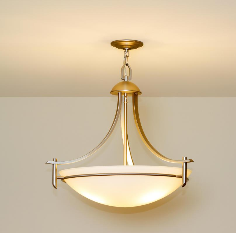 Installing decorative light fixtures is one part of interior design.