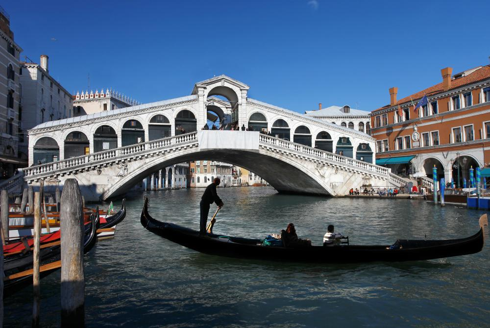 Gondolas and water taxis are used to transport people in Venice.