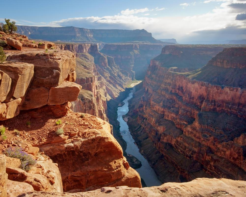The Colorado River runs through the Grand Canyon.