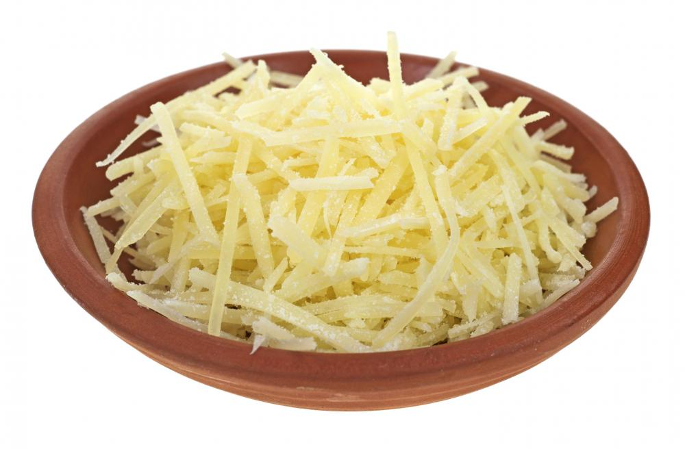 A small bowl of grated Parmesan cheese.