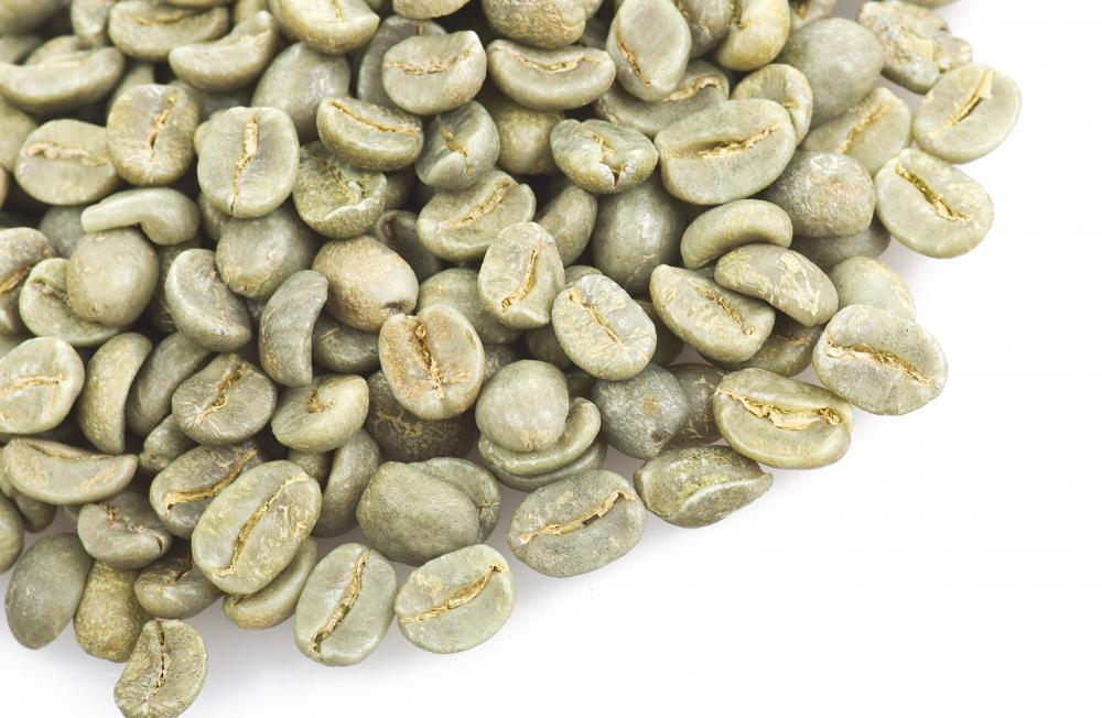 Green coffee beans are used in a coffee bean roaster.