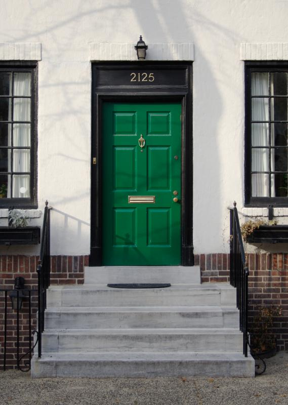 A stoop leading up to a green door in Philadelphia, Pennsylvania.