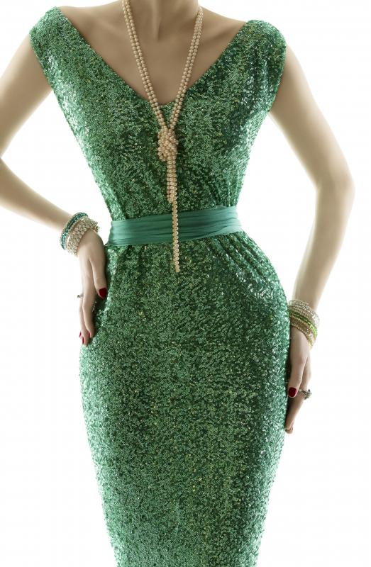 A cinched-waist dress can make the stomach look thinner and hips and top curvier.