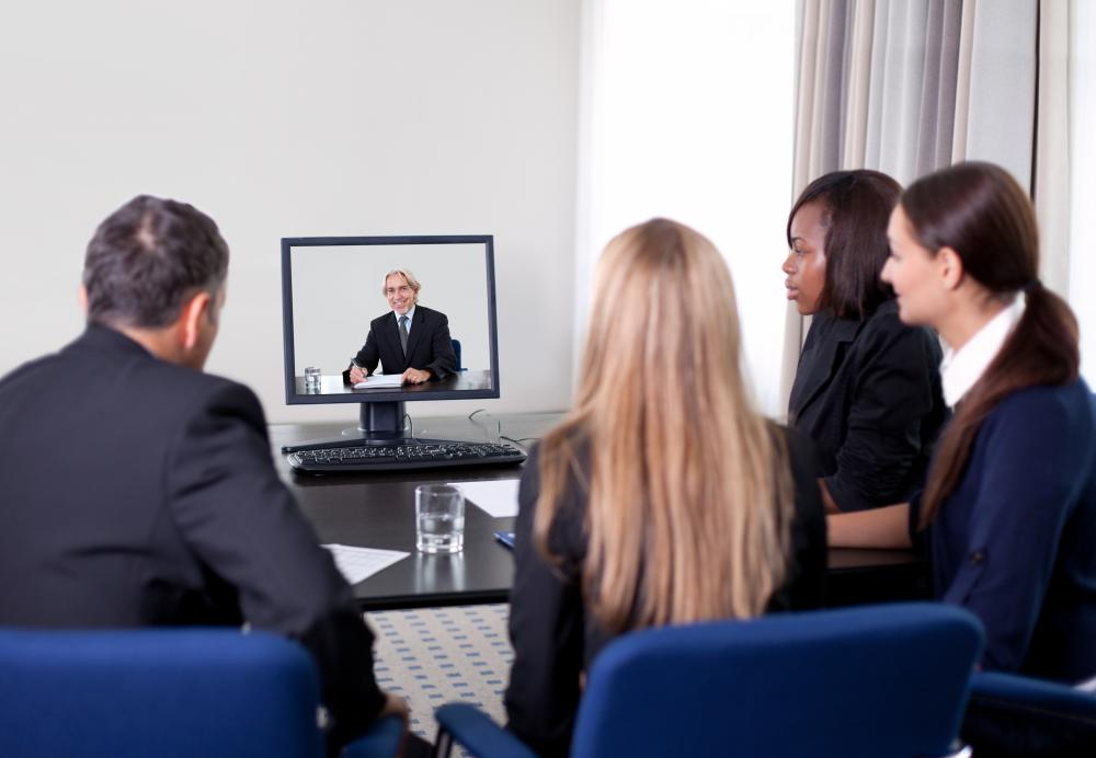 Group of businesspeople in a video conference.
