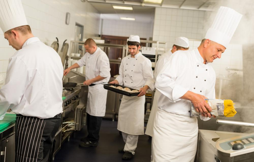 Food safety inspectors often oversee the working conditions of the staff in a restaurant.