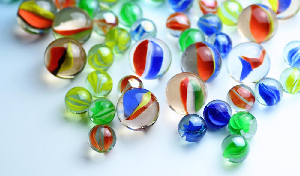Glass Marbles Game : What are wooden marbles with pictures